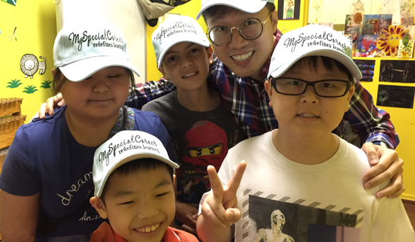Frederick Chu with kids from My Special Corner education centre