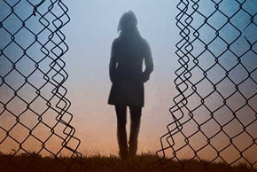 Woman in wire fence